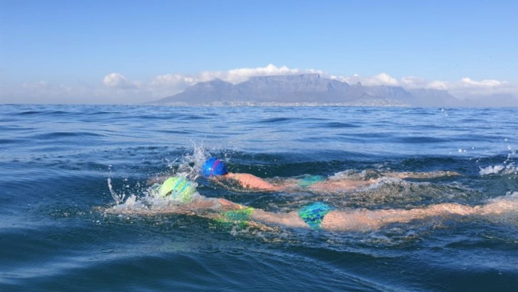 Robben Island swim training course open water swimmers with Table Mountain in background